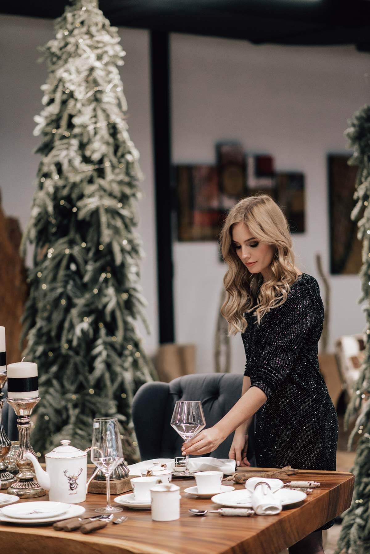 preparing Christmas table